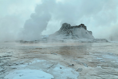 Castle geyser in the early morning fog at yellowstone national park