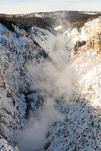 A vertical view down the grand canyon of the yellowstone with the falls at the rear.