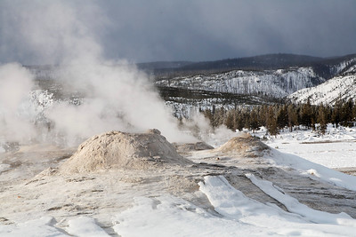 Geysers in old faithful basin yellowstone national park winter
