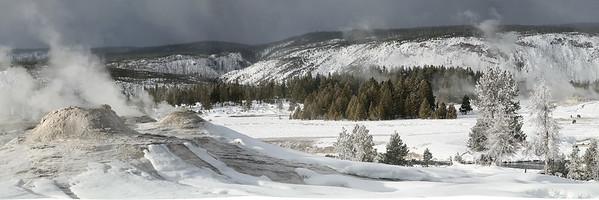Panoramic view of old faithful geyeser basin in winter