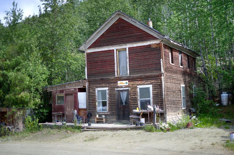 House near placer mine operation in Dawson City, Yukon, Canada