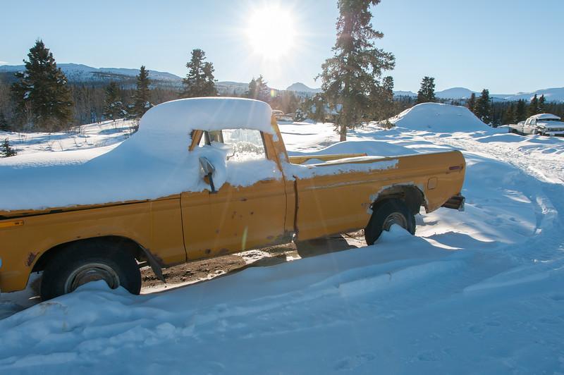 Snow covered truck during winter in Dawson City, Yukon, Canada