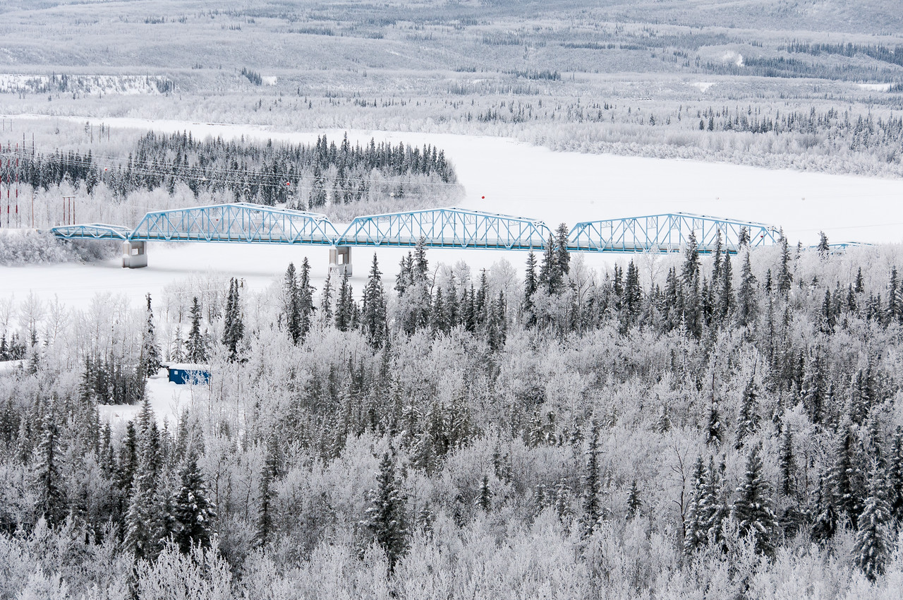 Aerial view of bridge over Yukon River during winter in Dawson City, Yukon, Canada