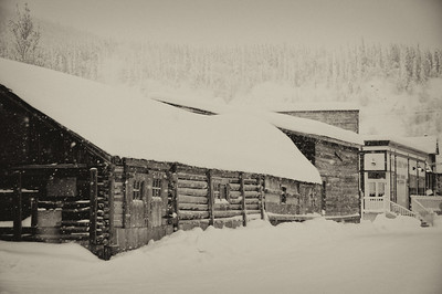 Snow covered log building in Dawson City, Yukon, Canada