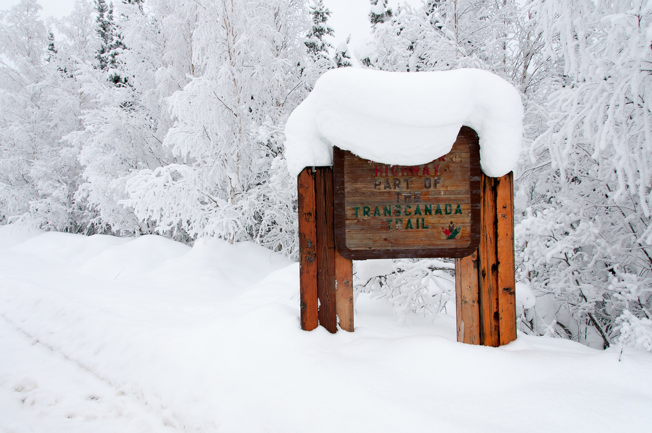 Waymark sign covered in snow at Dawson City, Yukon, Canada