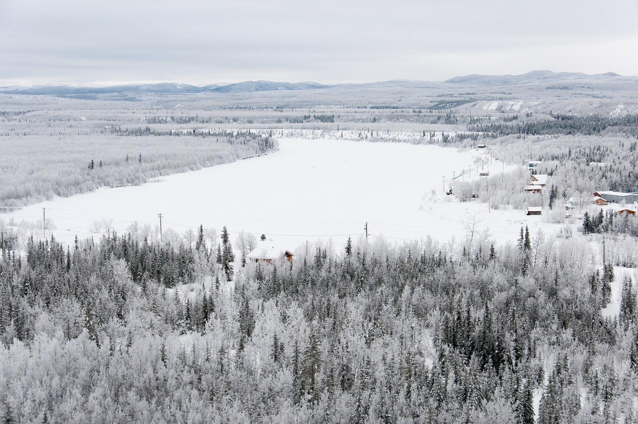 Yukon River covered in snow in Dawson City, Yukon, Canada