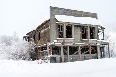 Old building covered in snow in Dawson City, Yukon, Canada