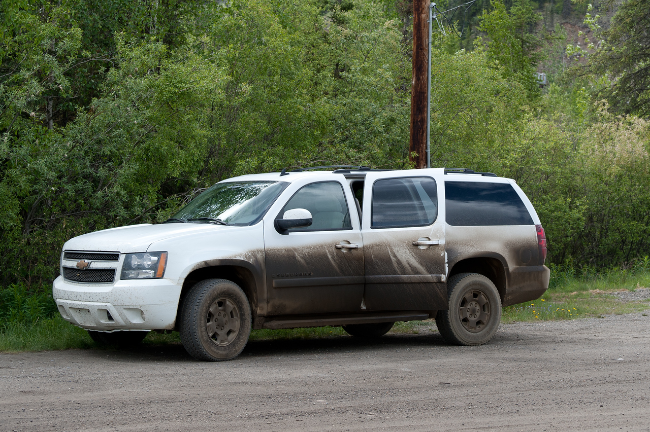 Dirt-filled SUV in Dempster Highway, Yukon, Canada