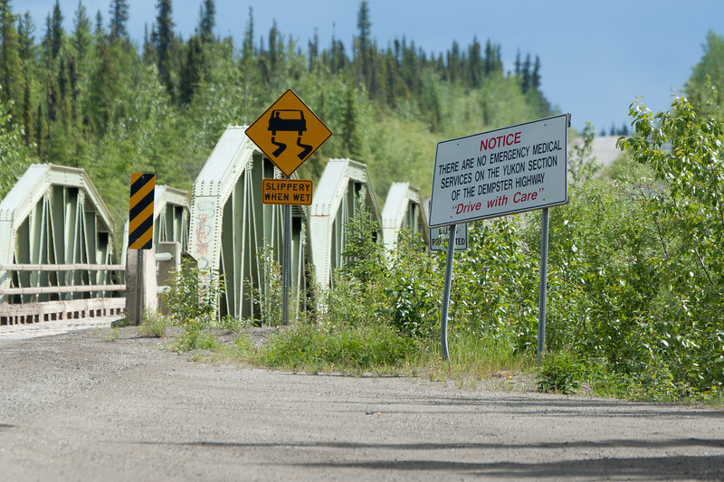 Sign near bridge in Dempster Highway, Yukon, Canada