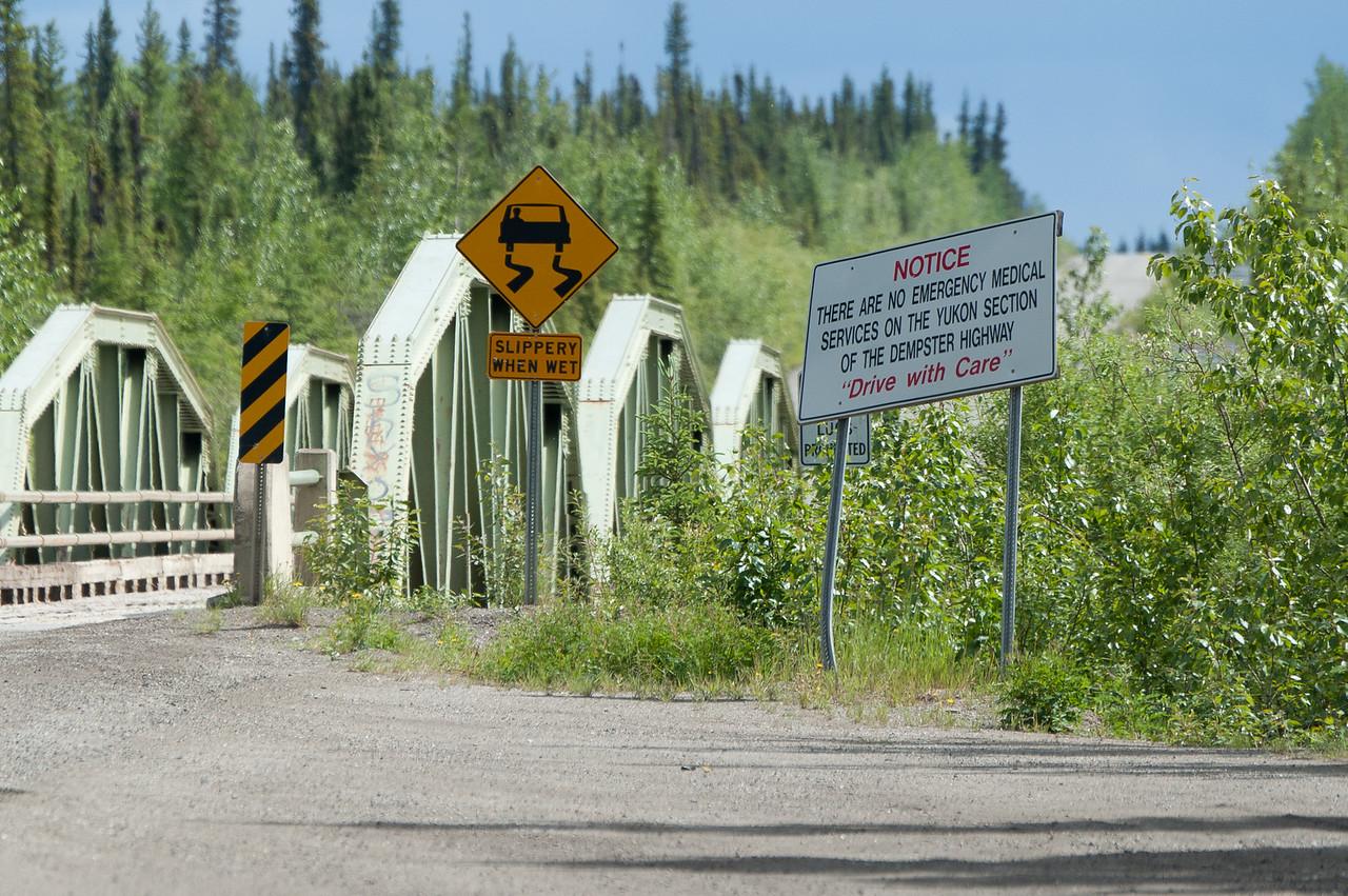 Sign near bridge in Dempster Highway, Yukon, Canada