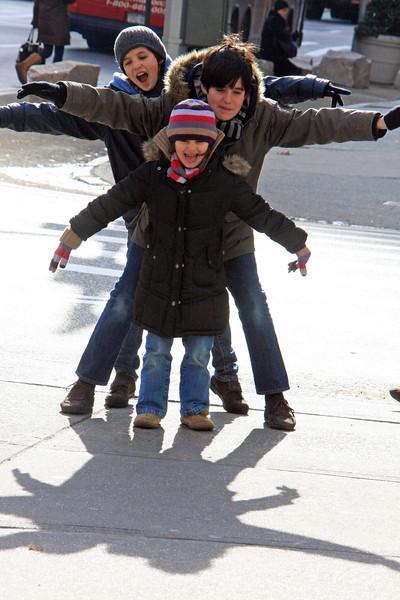 Kids playing with shadows, Flatiron, Manhattan, New York