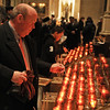 Lighting the candles of the Advent wreath at the Cathedral of Saint John the Divine, Manhattan, New York