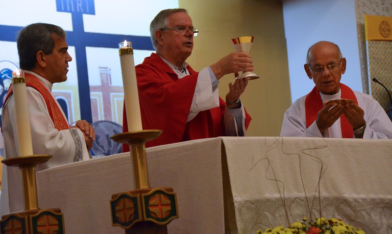 Fr. Giovani Pontes, Fr. John van den Hengel and Fr. Richard Woodbury celebrate Mass with the parish community