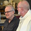 Fr. Johnny and Fr. Ed share a laugh before Mass