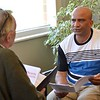 Fr. Louis talks with Fr. Claude during one-on-one sharing