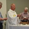 Fr. John, Fr, Jim and David Schimmel at Tuesday's Eucharist.