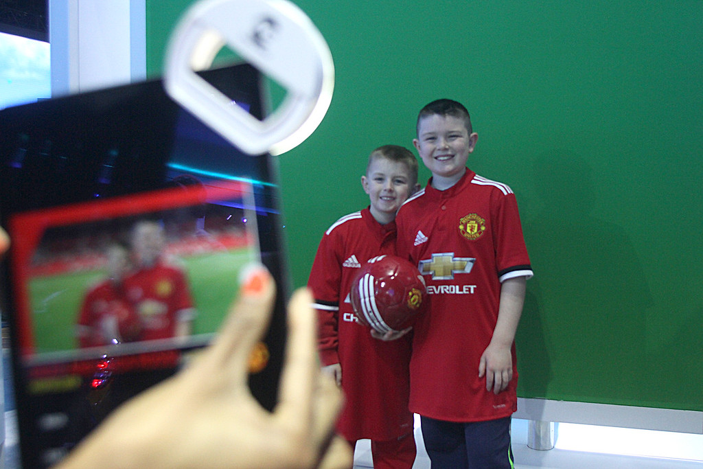. Among the interactive displays that got everyone\'s attention was the trading card booth. Posing together are Luca and Enzo Risso of St. Clair Shores. DAVID ANGELL - FOR THE MACOMB DAILY