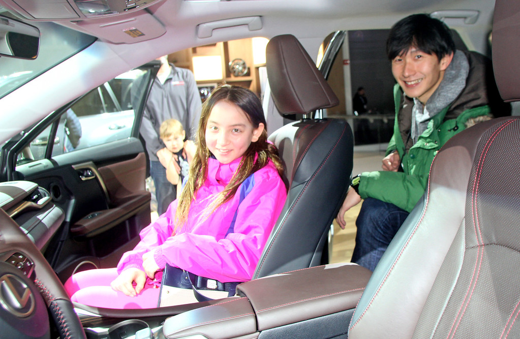 . Sara Tim (Washington Twp) checks out a Lexis with friend Masa Nagata from Japan