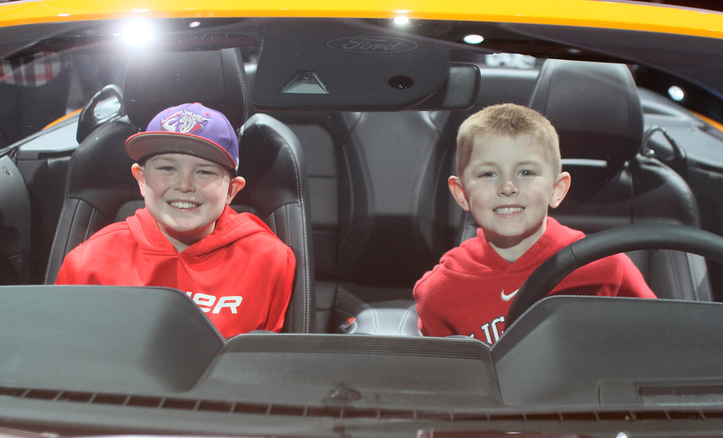 . Enzo and Luca Rossi of St. Clair Shores check out the new Ford Mustang during Saturday\'s public opening of the North American International Auto Show, where attendance was up by more than a few thousand.  DAVID ANGELL- FOR THE MACOMB DAILY
