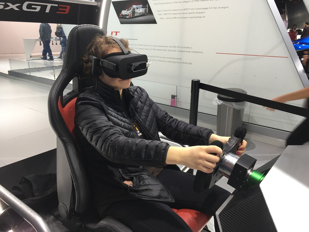 . Experiencing the thrill of race car driving on a simulator at the NAIAS is Courtney Hodges, 17, of Rochester Hills. GINA JOSEPH - THE MACOMB DAILY