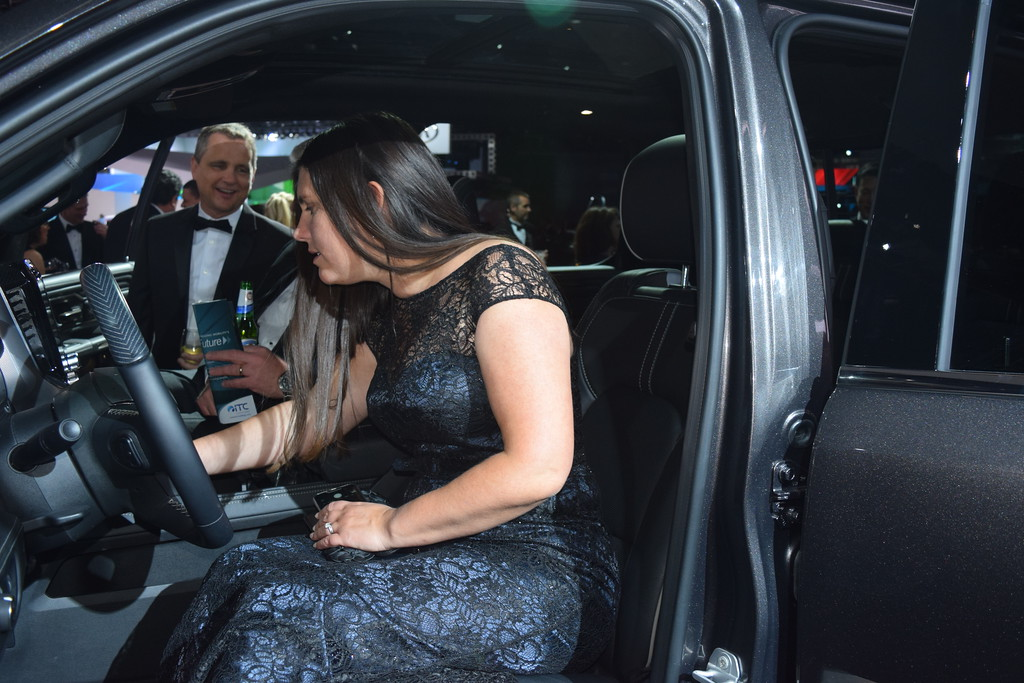 . Even the women who attended the NAIAS Charity Prevent event were interested in the new trucks and SUV\'s including Lisa DiMaggio, senior management engineer with Toyota, which makes the Tundra, seen here checking out the Dodge RAM 1500. MITCH HOTTS - THE MACOMB DAILY