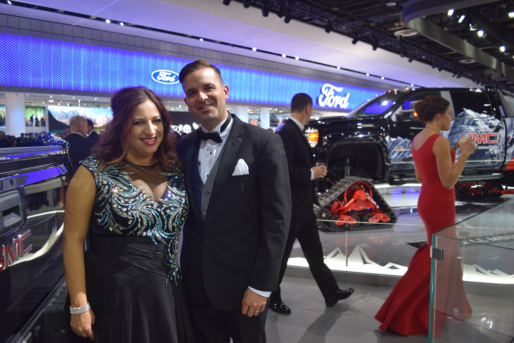 . Lorie Barnwell, Warren City Treasurer and her husband Bill Barnwell, pose for the cameras during the Charity Preview event at the NAIAS on Friday. MITCH HOTTS - THE MACOMB DAILY