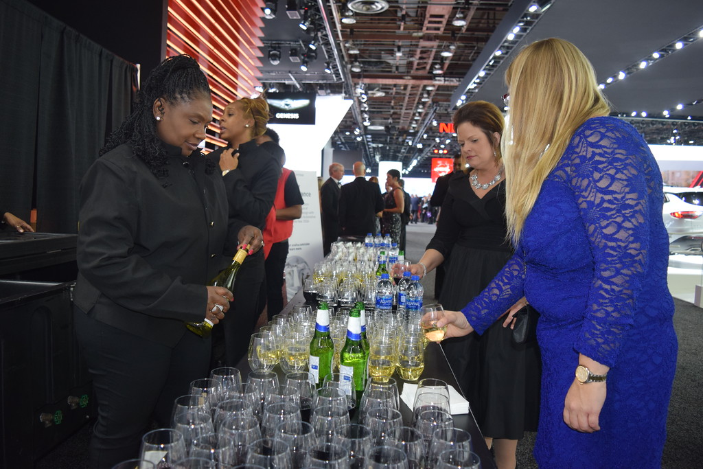 . Guests grab a beverage before perusing the NAIAS\'s Charity Preview party on Friday. MITCH HOTTS - THE MACOMB DAILY