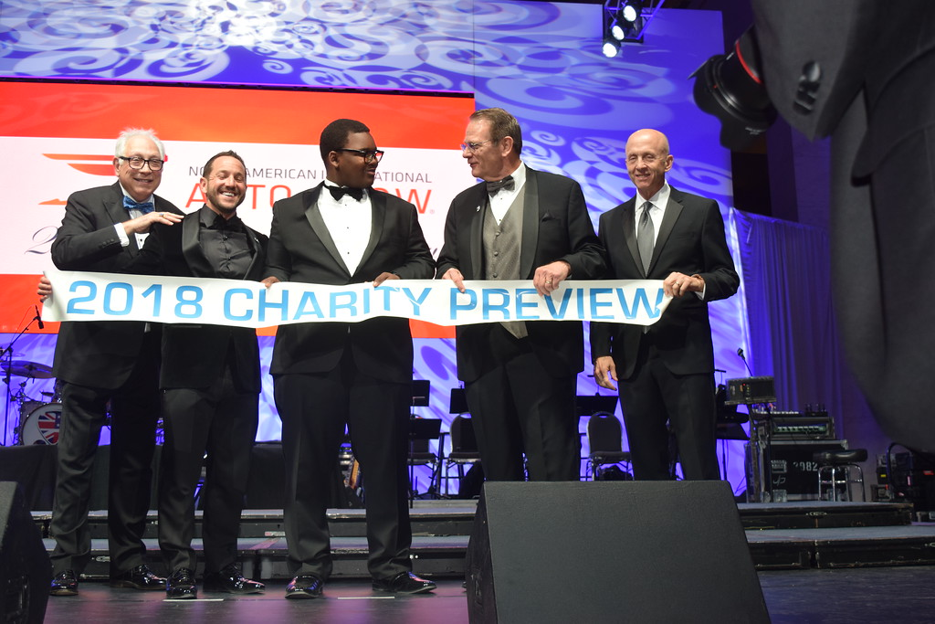 . Paul W. Smith, WJR-AM (760), far left, joins a group from Detroit Auto Dealers Association (DADA) in kicking off the annual Charity Preview Party at the NAIAS on Friday. MITCH HOTTS - THE MACOMB DAILY