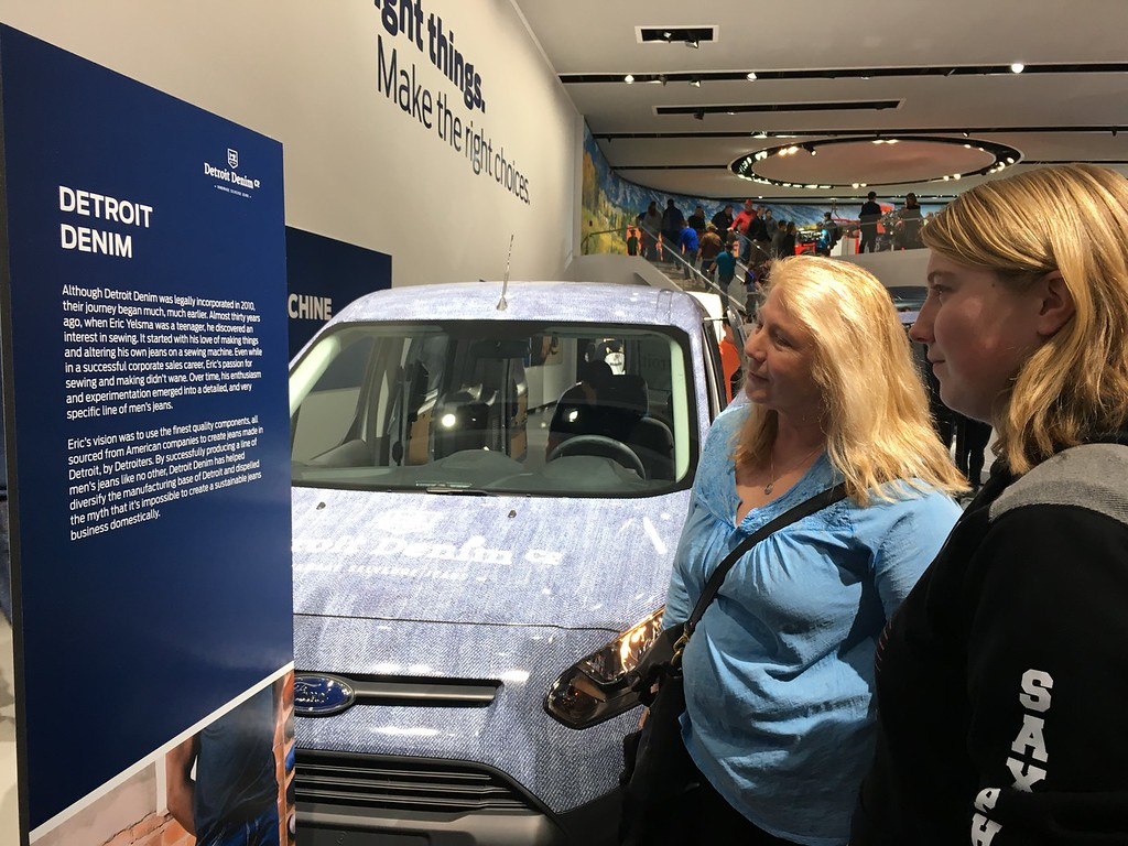 . Denise Myers and her daughter, Lindsay Myers of Clarkston read the story about Detroit Denim and how it got its start. Ford featured the company with a Ford utility van wrapped in denim. GINA JOSEPH - THE MACOMB DAILY