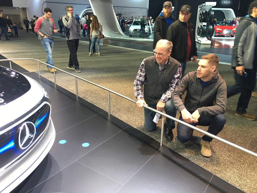 . Al and David Campanella of Philly check out a Mercedes during Saturday\'s public opening of the NAIAS. A large crowd attended the opening day event including many families like the Campanella\'s who have made the trip a tradition. GINA JOSEPH - THE MACOMB DAILY