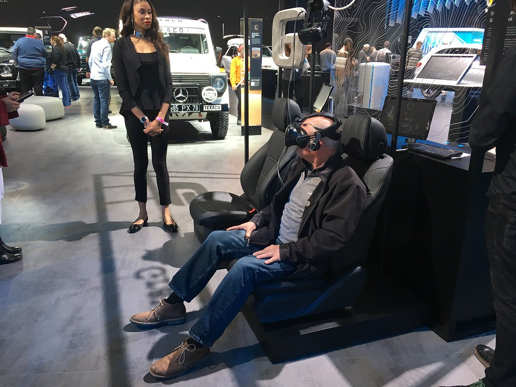 . Dave Baldock of Midhurst, Ontario takes a cruise in a Mercedes\' SUV via the simulator on display at the NAIAS. GINA JOSEPH - THE MACOMB DAILY