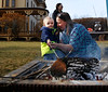 HOLLY PELCZYNSKI - BENNINGTON BANNER Colton Senecal, 2 years old of Woodford roasts some marshmallows with the help of his mom Stephanie Senecal at the Park–McCullough Historic House where a bonfire was held and free smore's during the North Bennington Winterfest held on Saturday in North Bennington.