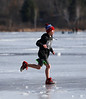HOLLY PELCZYNSKI - BENNINGTON BANNER Mason Crosier, 12 years of of North Bennington runs across the ice dressed in shorts during the 2018 Winterfest event held on Saturday in North Bennington, where temps raised to 45 degrees.