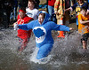 HOLLY PELCZYNSKI - BENNINGTON BANNER Bear Goldberg, of Pownal rushes into the waters of Lake Paran while representing the Southshire Roller Derby during the penguin plunge event held during the North Bennington Winterfest held on Saturday in North Bennington.