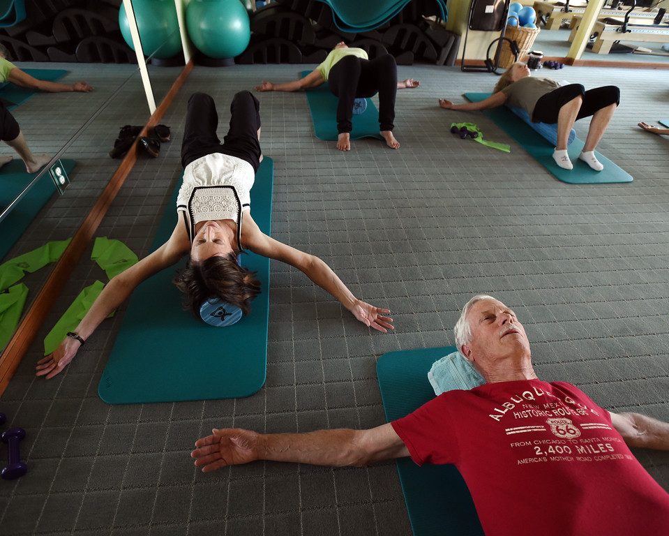 . Michelle Harris, left, teaches the North Boulder Pilates class.John Farnbach is on the bottom right.  Cliff Grassmick  Staff Photographer  August 7, 2018