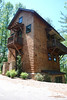 "The Sassafras Tree House at The Village of Cheshire in Black Mountain, NC.  This plan is 1,530 Heated Square Feet, 3 Bedrooms and 2 1/2 Bathrooms. The master bedroom is on the main floor with living above. The dimensions are 28'-0"" x 35'-0"". NC0023"