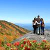 Family enjoying beautiful autumn view on  hiking trip in mountains.
