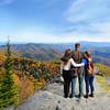 Family hiking in autumn mountains enjoying beautiful mountain view,.