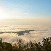 Beautiful mountain scenery with clouds over the hills  at sunrise. Close to Blowing Rock, Blue Ridge Parkway, North Carolina, USA.
