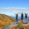 Family enjoying hiking trip in the  autumn mountains..