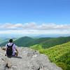 Man   enjoying  beautiful summer mountain  view.