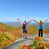 People with hands up looking at beautiful summer mountains landscape.Couple on hiking trip, Near Asheville ,Blue Ridge Mountains, North Carolina, USA.