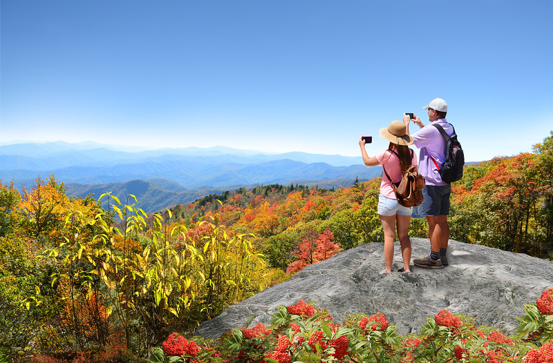 People enjoying beautiful mountain view on hiking trip.