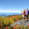 People enjoying beautiful mountain view on hiking trip.