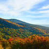Beautiful, colorful fall mountain landscape. Road winding through mountain forest in autumn color. Blue Ridge Parkway. Close to Blowing Rock, North Carolina, USA.