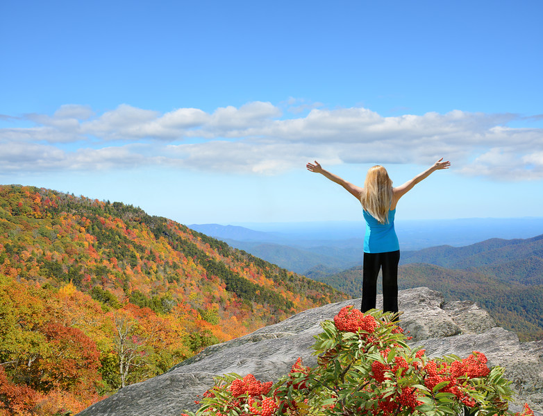 Woman enjoying beautiful view on top of the mountain.