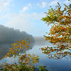 Beautiful lake  in colorful forest , blue cloudy sky  reflected in the water. Price Lake on the Blue Ridge Parkway, near Blowing Rock, North Carolina, USA