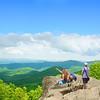 Family  enjoying beautiful view on hiking trip in mountains.