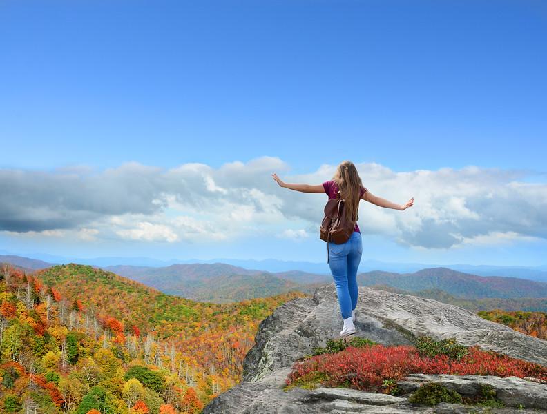 Girl having fun on top of the mountain.