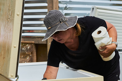 Samantha Forzano of Bryson City, North Carolina, cleans a refrigerated cooler that will be filled with water to hold the processed chickens before packaging at Gnome Mountain Farms in Franklin, North Carolina, Sunday, June 27, 2021. (Joseph Forzano / Deep Creek Films)